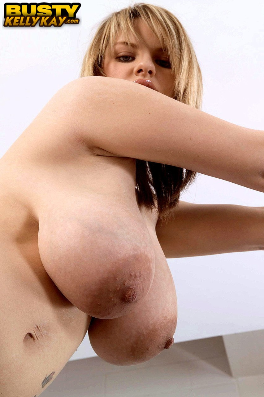 Solo model Kelly Kay reveals her giant tits prior to riding her vibrator