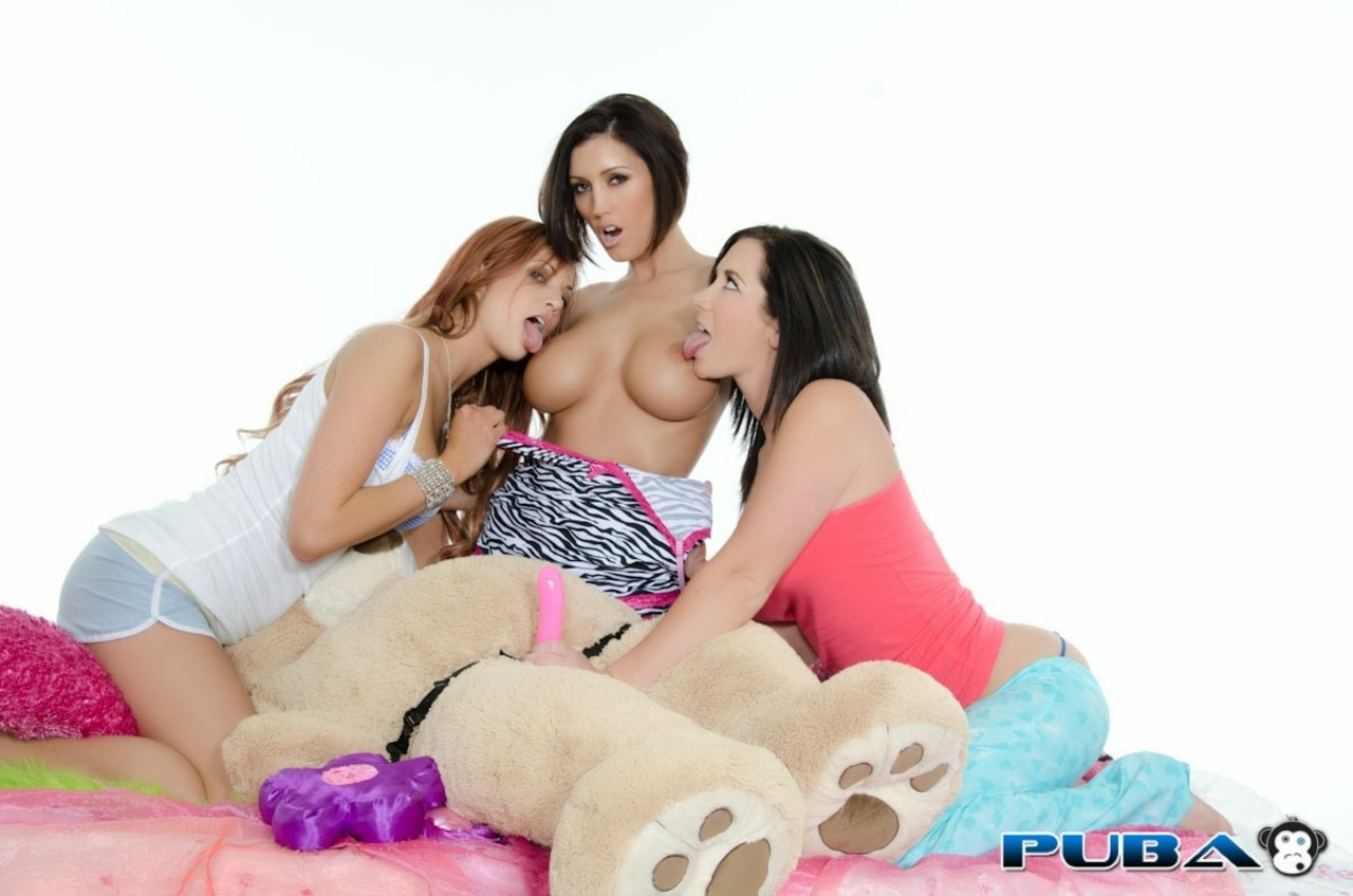 Horny girls attach a strapon to teddy bear during an all girl threesome