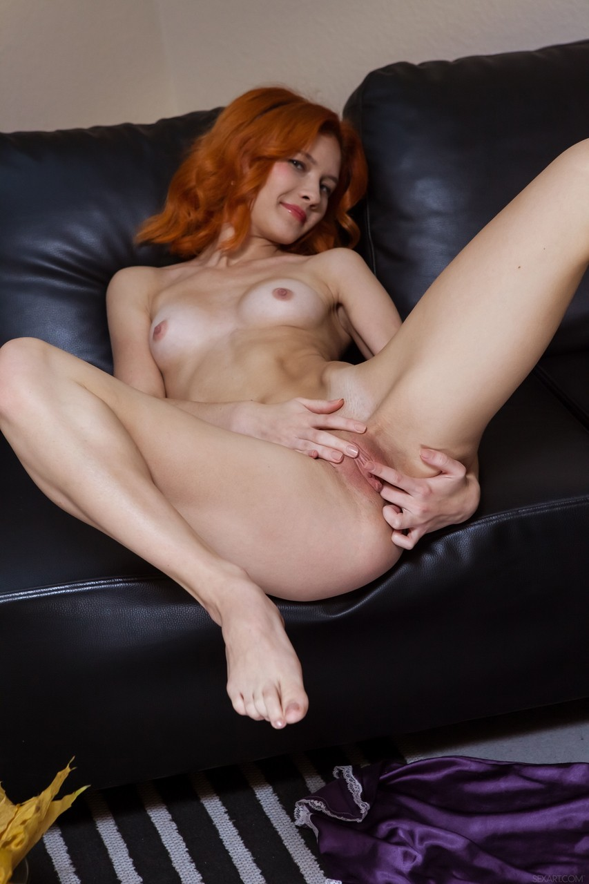 Pale redhead Ambre folds back her labia lips during a close up of her pussy