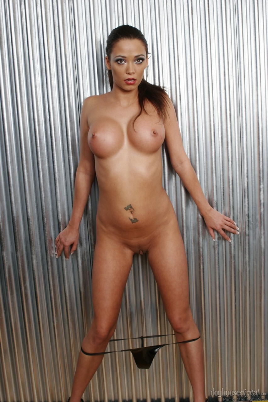 Brunette female takes a dildo out of a girl