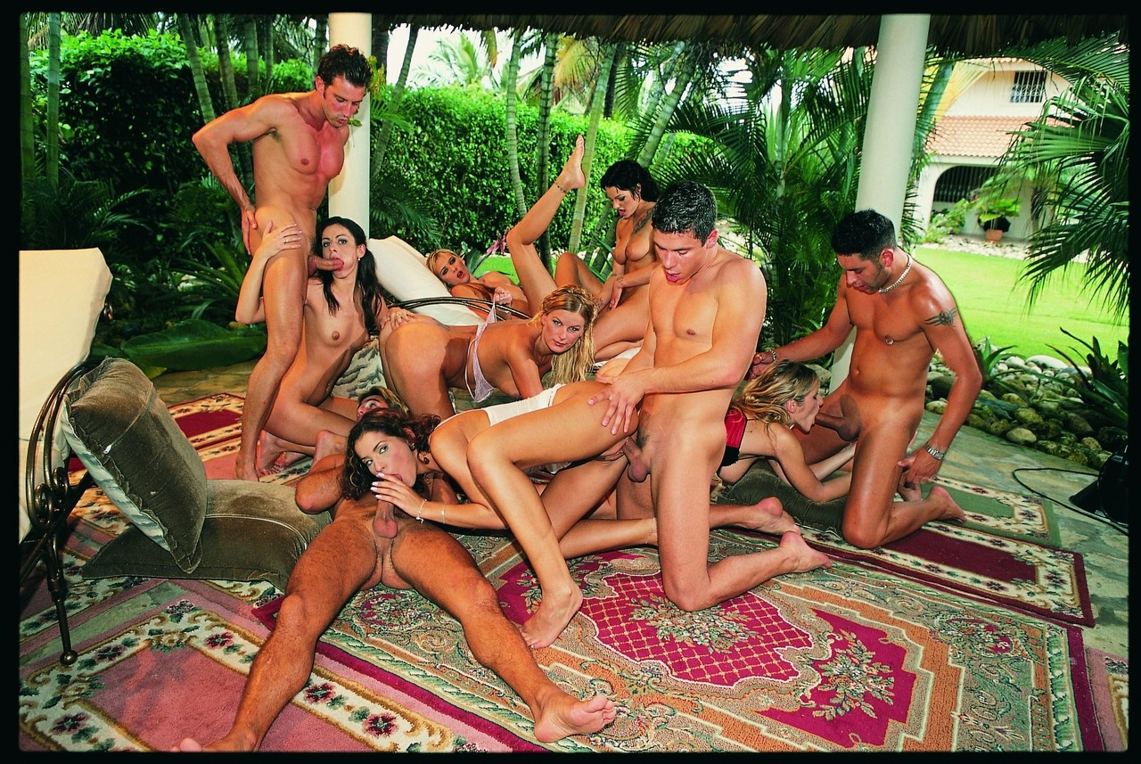A gaggle of pornstars gather for groupsex fucking out in the backyard