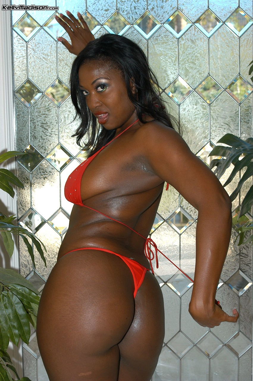 Hot black chick Aryana Starr gets oiled up after removing her red bikini