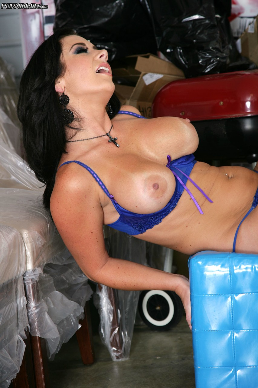 Dark haired chick Jayden Jaymes bares her big tits with a striptease in garage