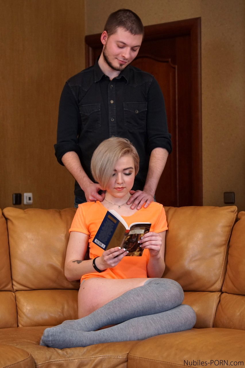 Short haired blonde Emmy Space fucks her man in long socks after a neck rub