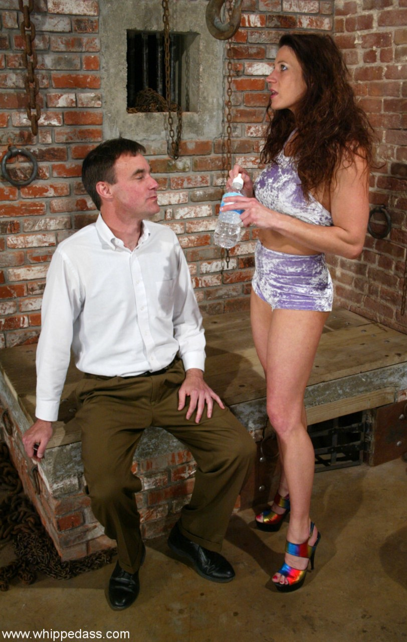 Clothed female Kym Wilde makes a man strip to his underwear and socks