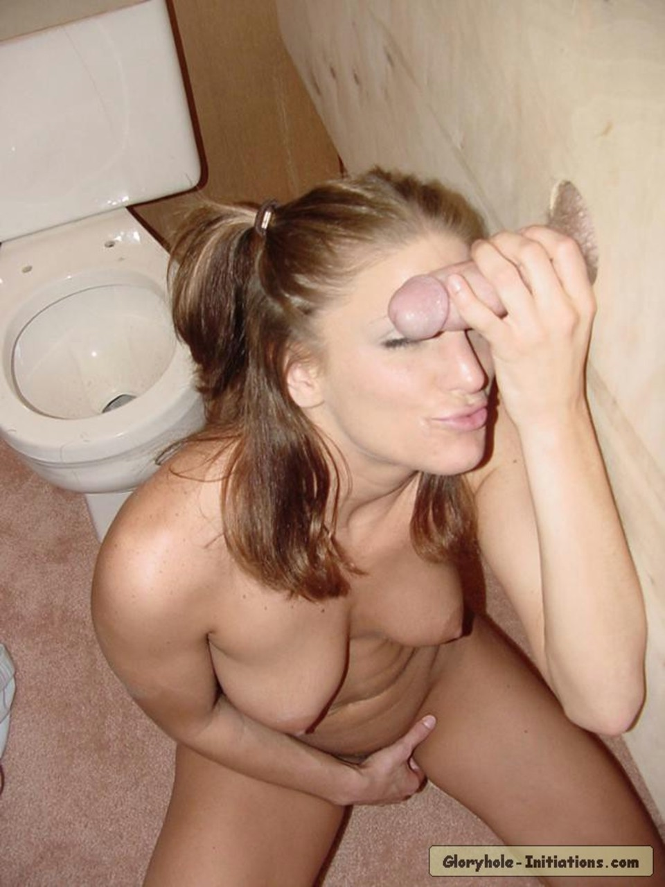 Blonde slut in pigtails goes 1 on 1 with a cock via a bathroom gloryhole