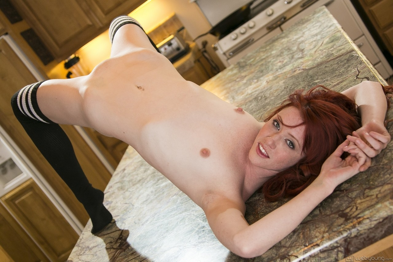 Pale redhead with freckles Elle Alexandra satisfies her horny cunt on counter