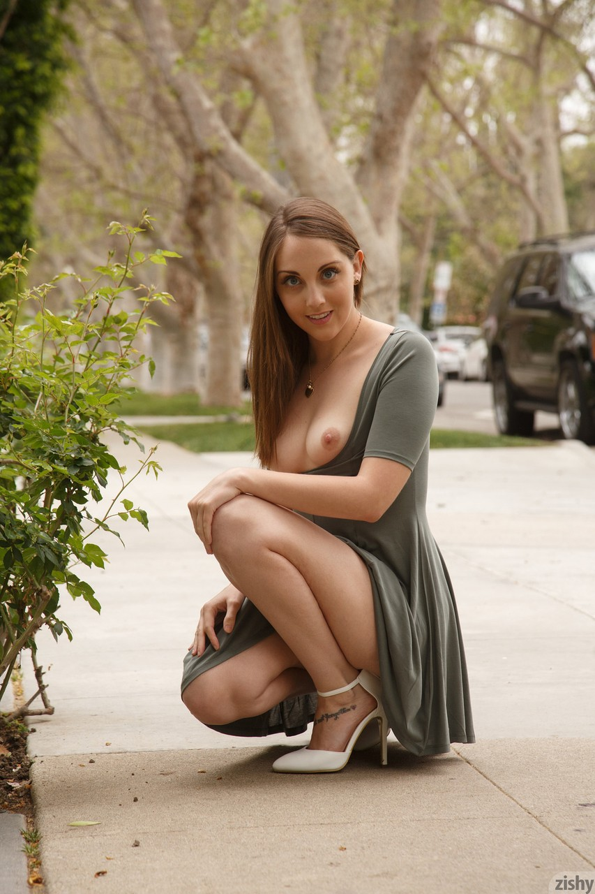 Naughty brunette Nickey Huntsman flashes her tits and ass while out in public
