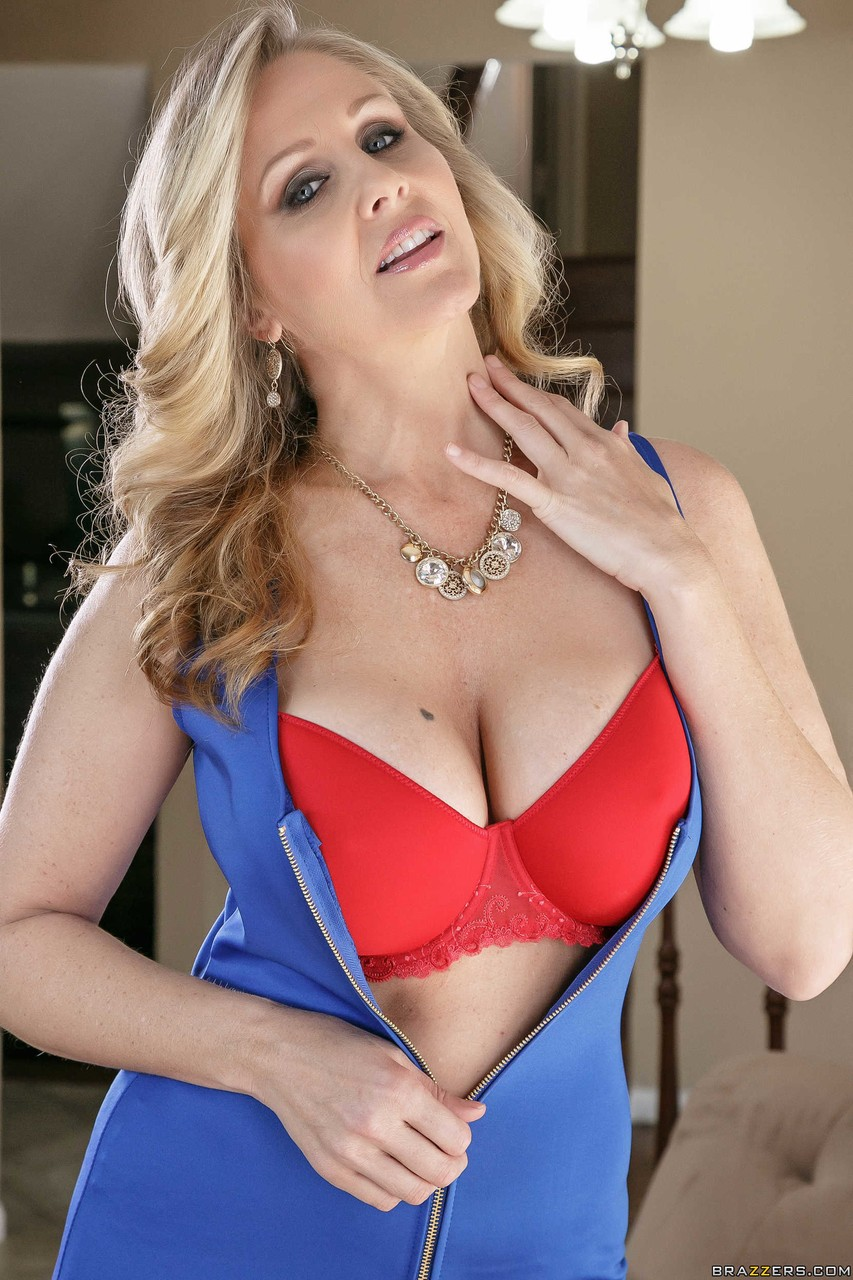 Incomparable MILF pornstar Julia Ann strips nude to show her huge big tits