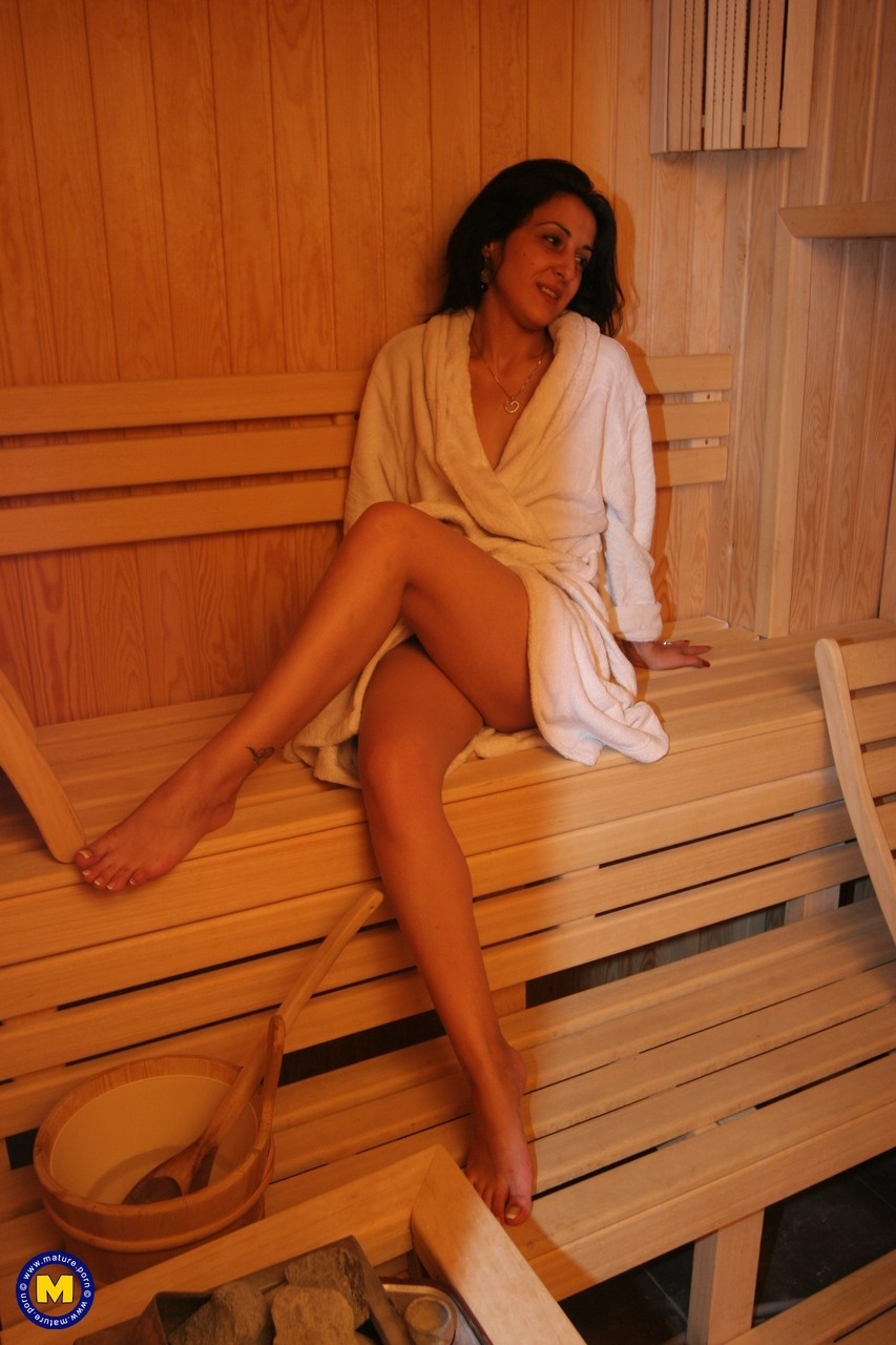 Mature brunettes with natural tits undress to hang out naked in the sauna