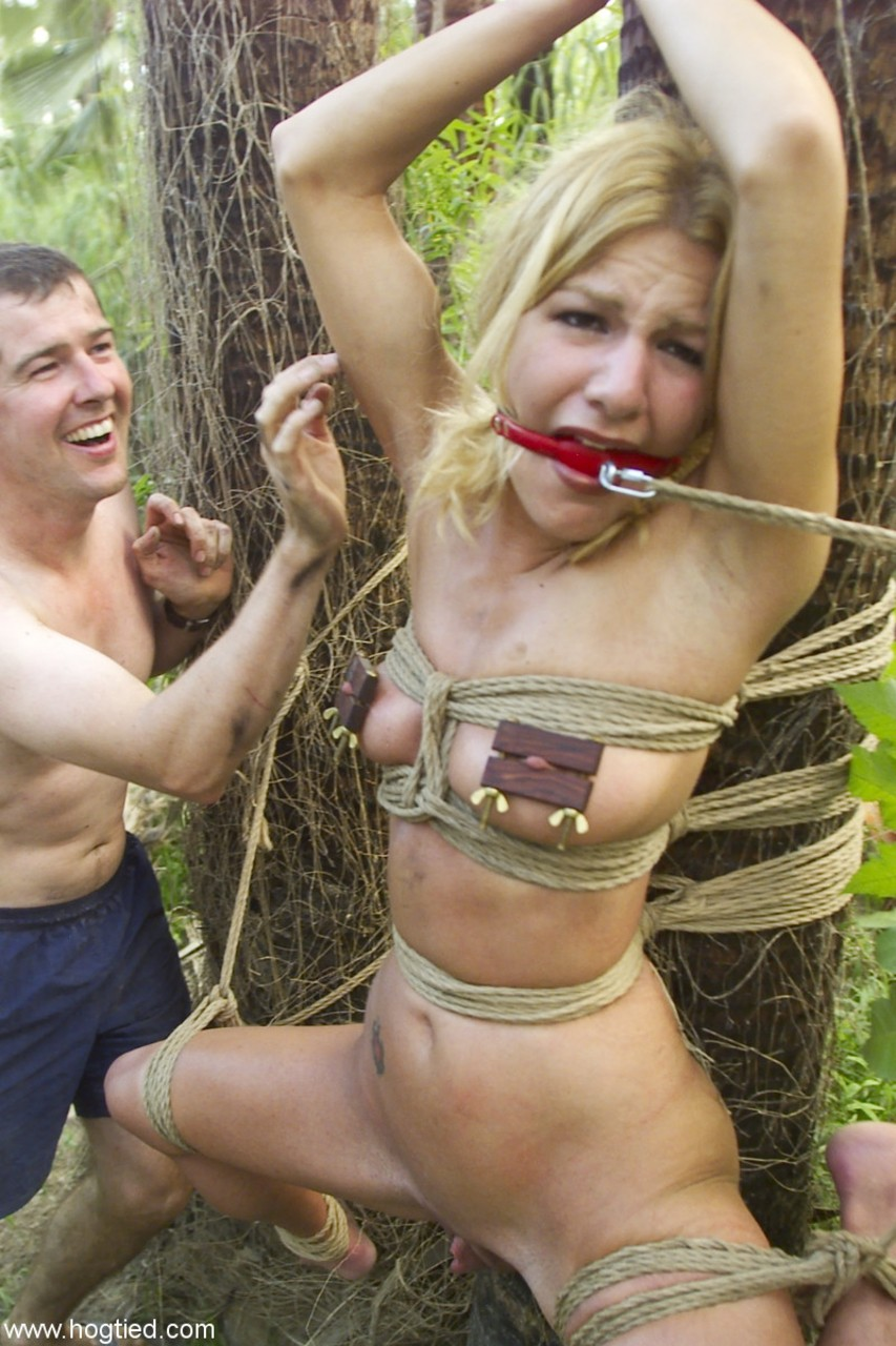Babe tied up on a tree fucked in group