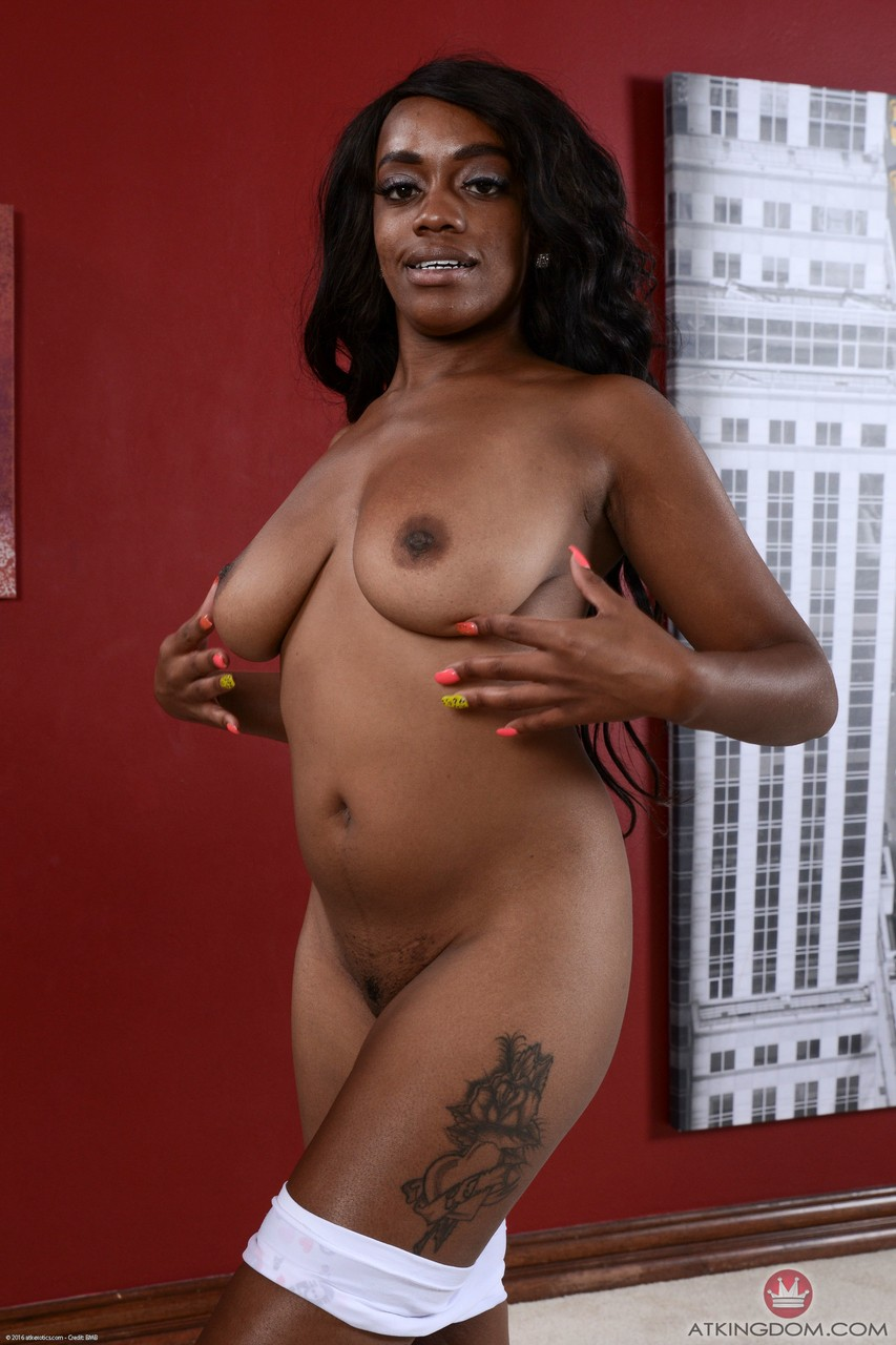 Ebony girl Amber Cream with tattoo likes to spread legs and expose pink pussy