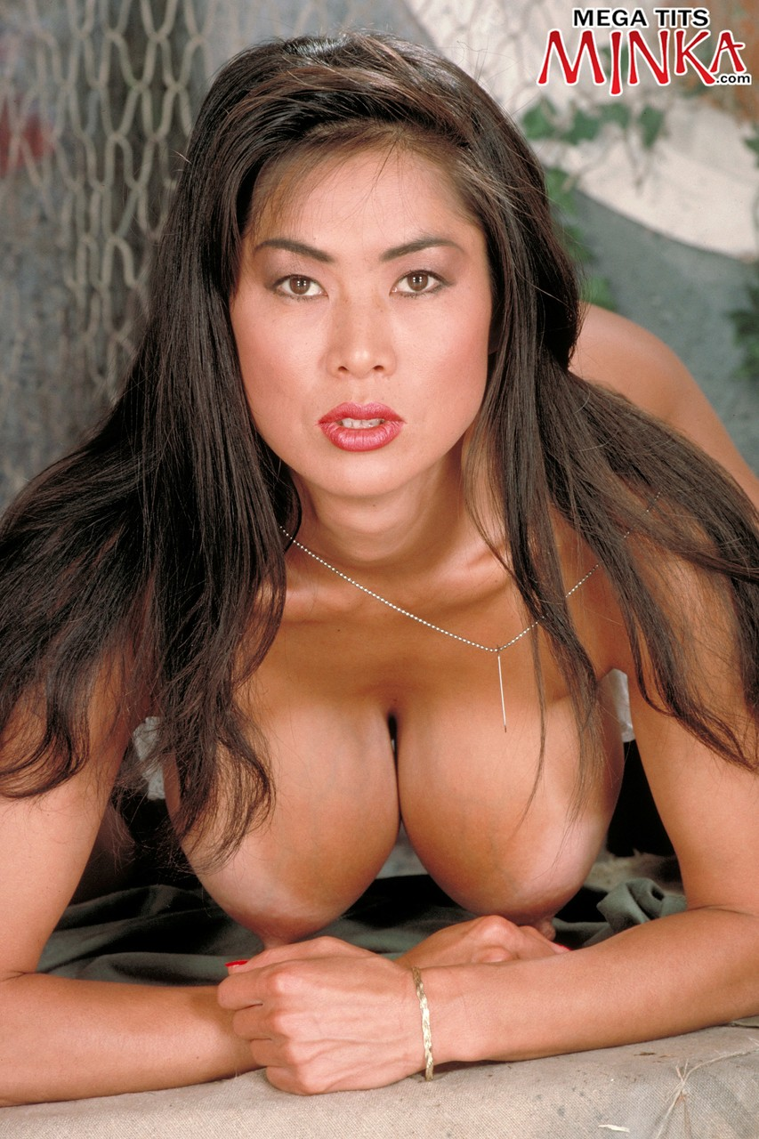 Gorgeous green eyed Asian Minka releases great big tits to spread in boots