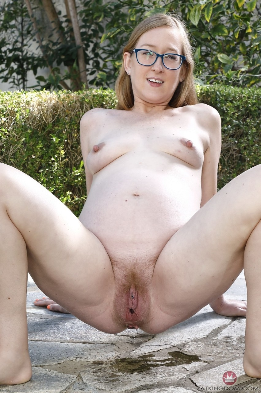 Glasses clad mom-to-be Skye Avery spreads her pierced pussy wide in the park