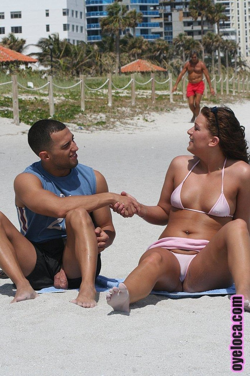 Petite Latina with a bubble butt Amber Fuentes fools around at the beach