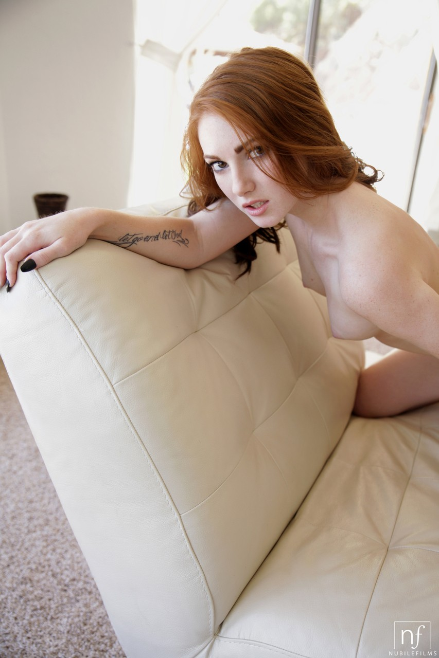 Flawless young redhead Natalie Lust uncovers small boobs for hot masturbation