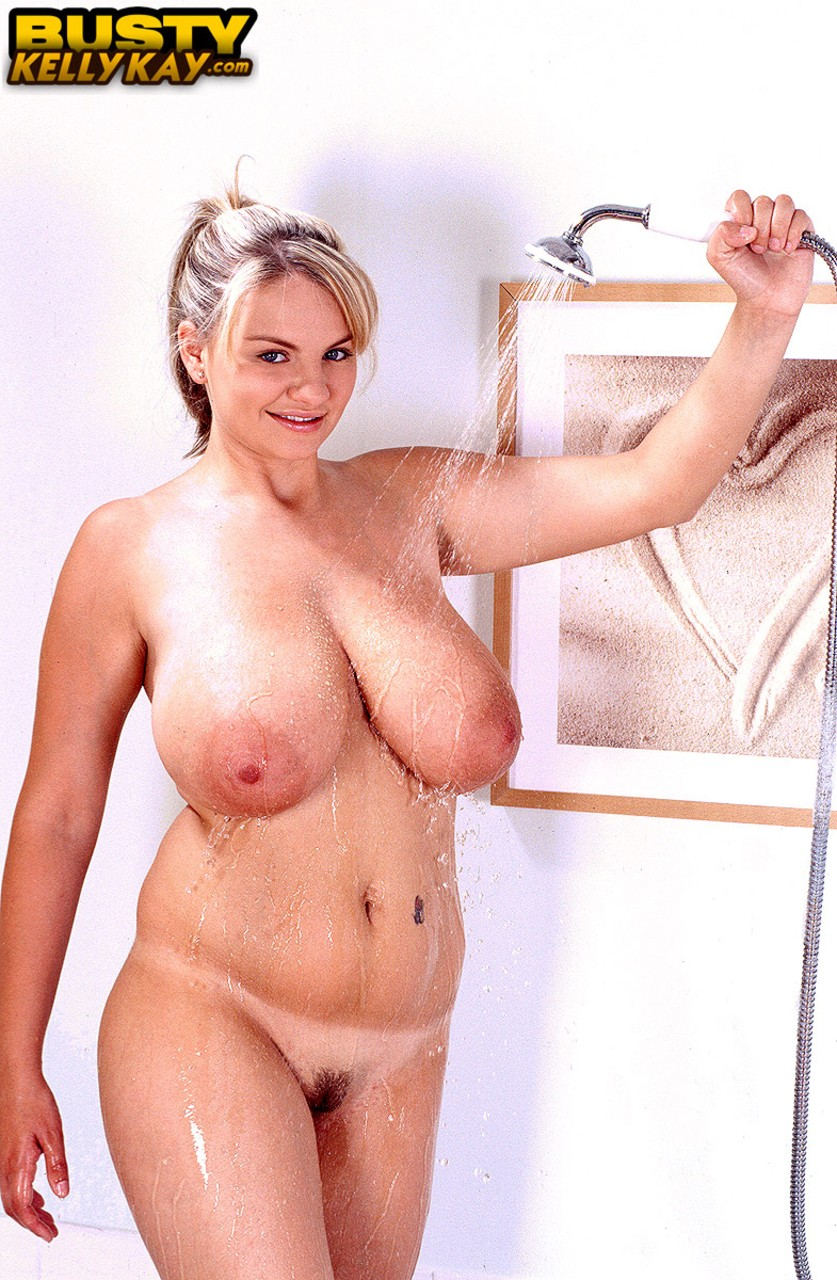 Large breasted blonde Kelly Kay wets her huge tits  soaps them in the shower