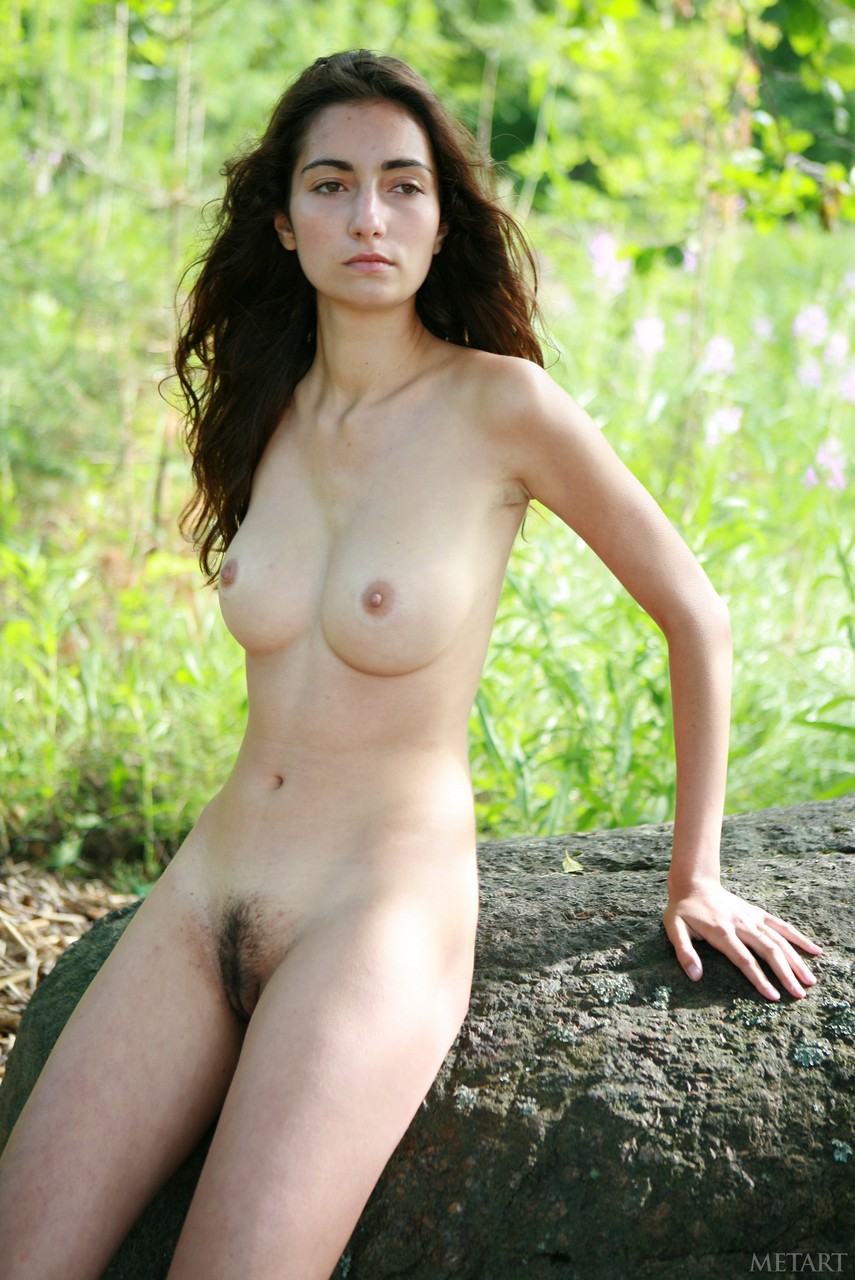 Sexy young nude woman with long black hair