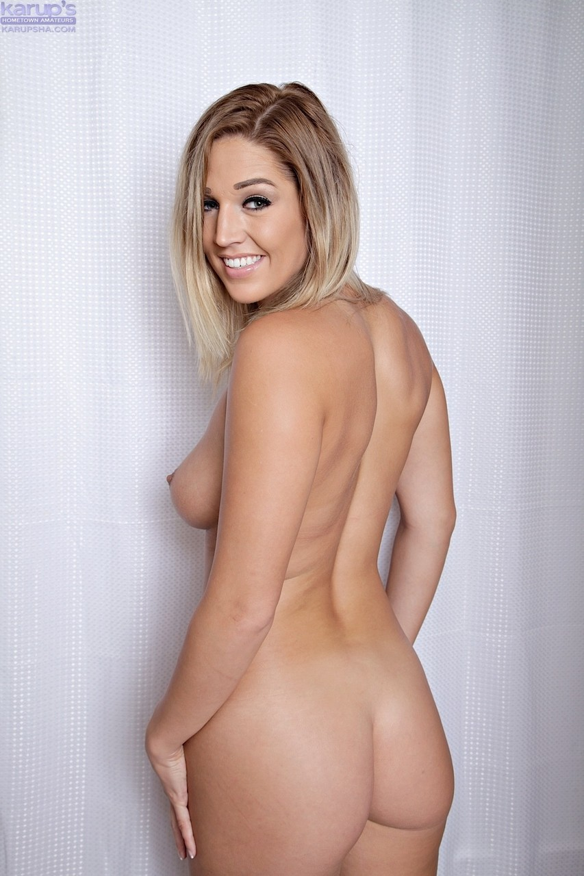 Sweet girl with cute smile Val Dodds takes off silk robe and lace lingerie
