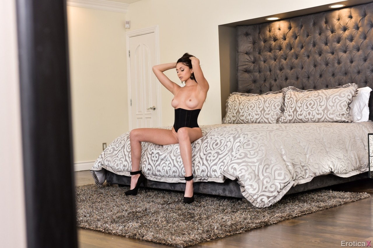 Gorgeous model Ariana Marie puts whip aside and takes off corset and panties