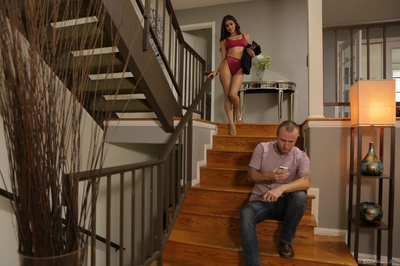 Slender black-eyed babe Sophia Leone gives blowjob right on the stairs