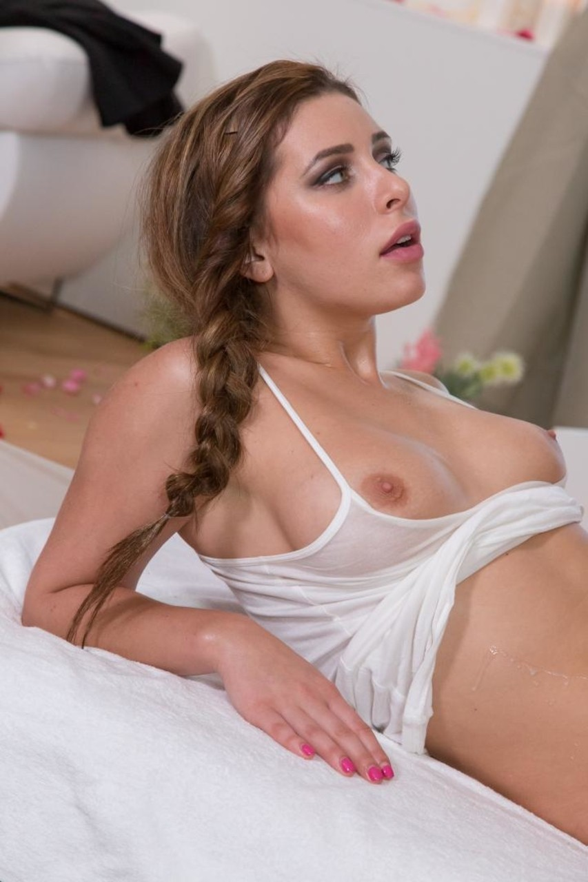 Erotic model Ally Breelsen gives a sensual oiled cock massage  climbs aboard