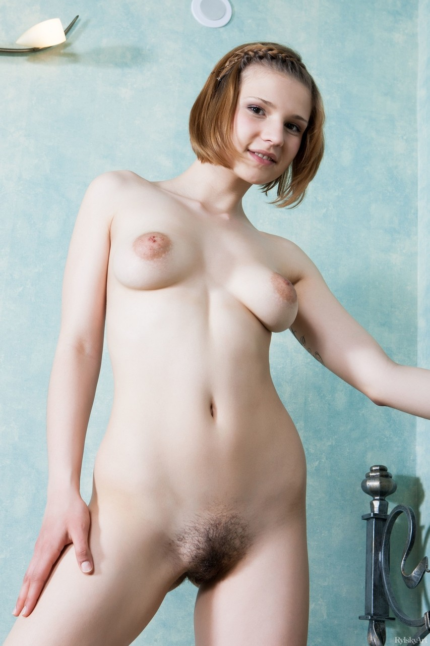 Adorable young Mariam with big puffy nipples vaunts her natural hairy pussy
