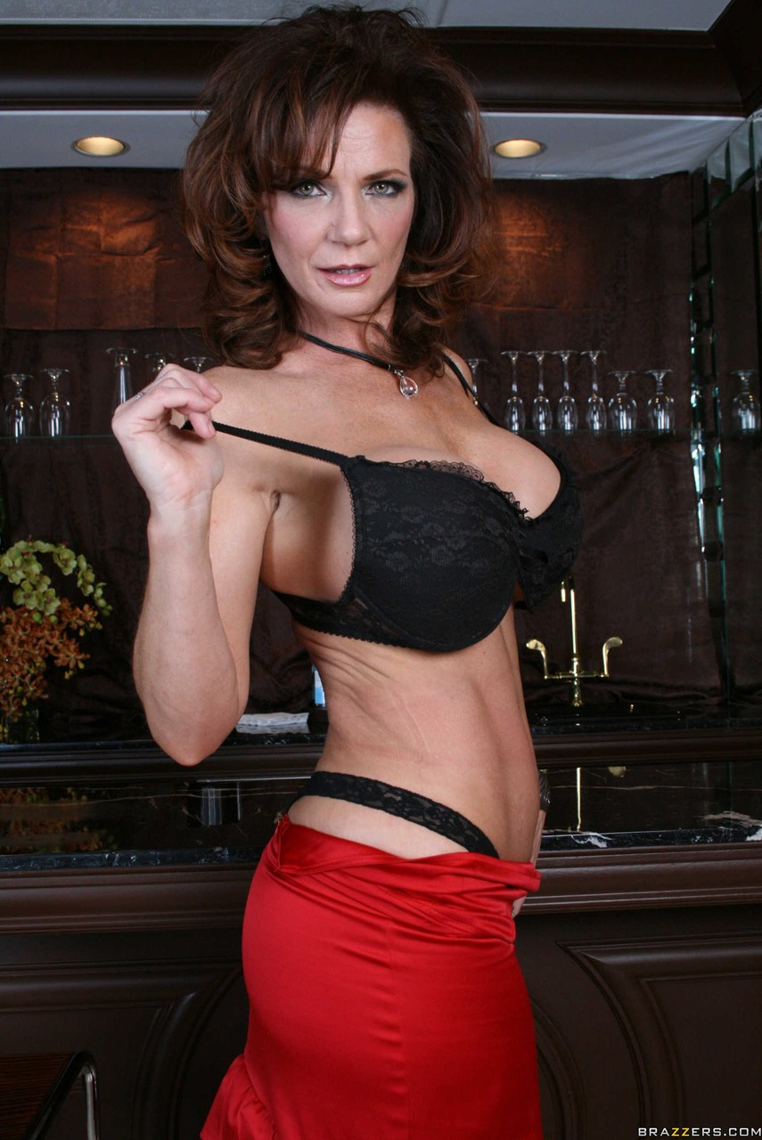 Mature redhead Deauxma posing with her outstanding big tits and butt