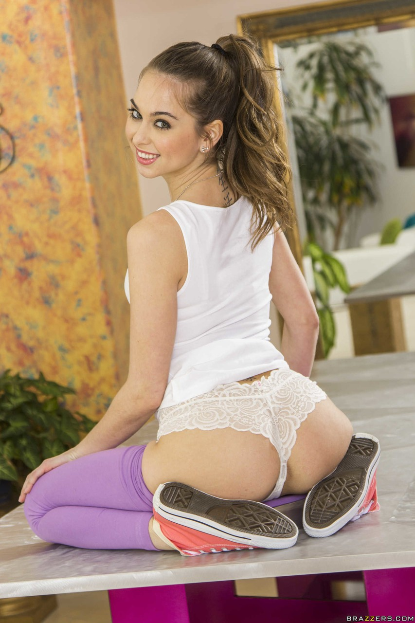 Stunning girl Riley Reid strips and poses naked with her hairy cunt