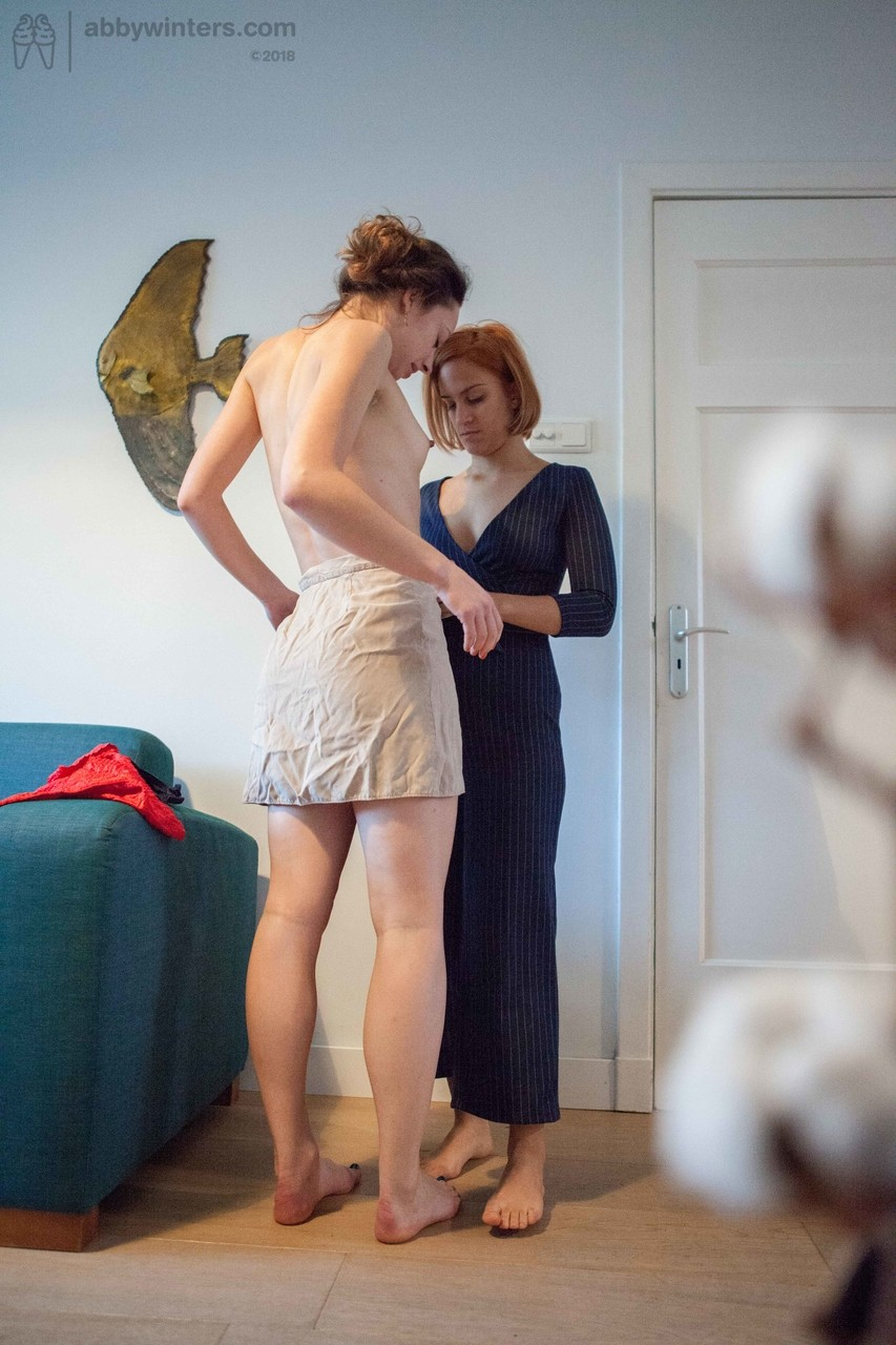 Lesbian babes Luciana & Abigail M show natural bush while dressing each other