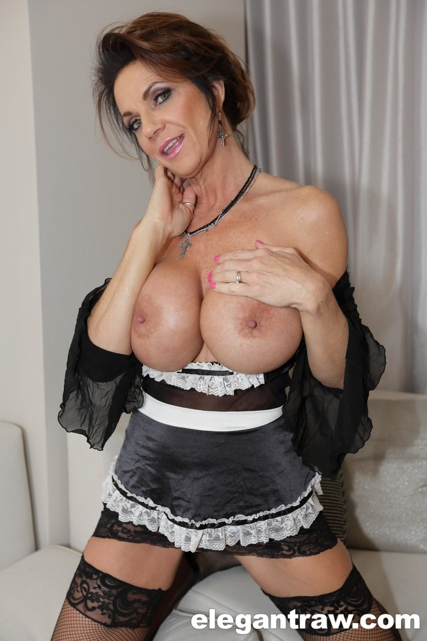 Busty maid Deauxma fondles her enhanced big tits while riding big black cock