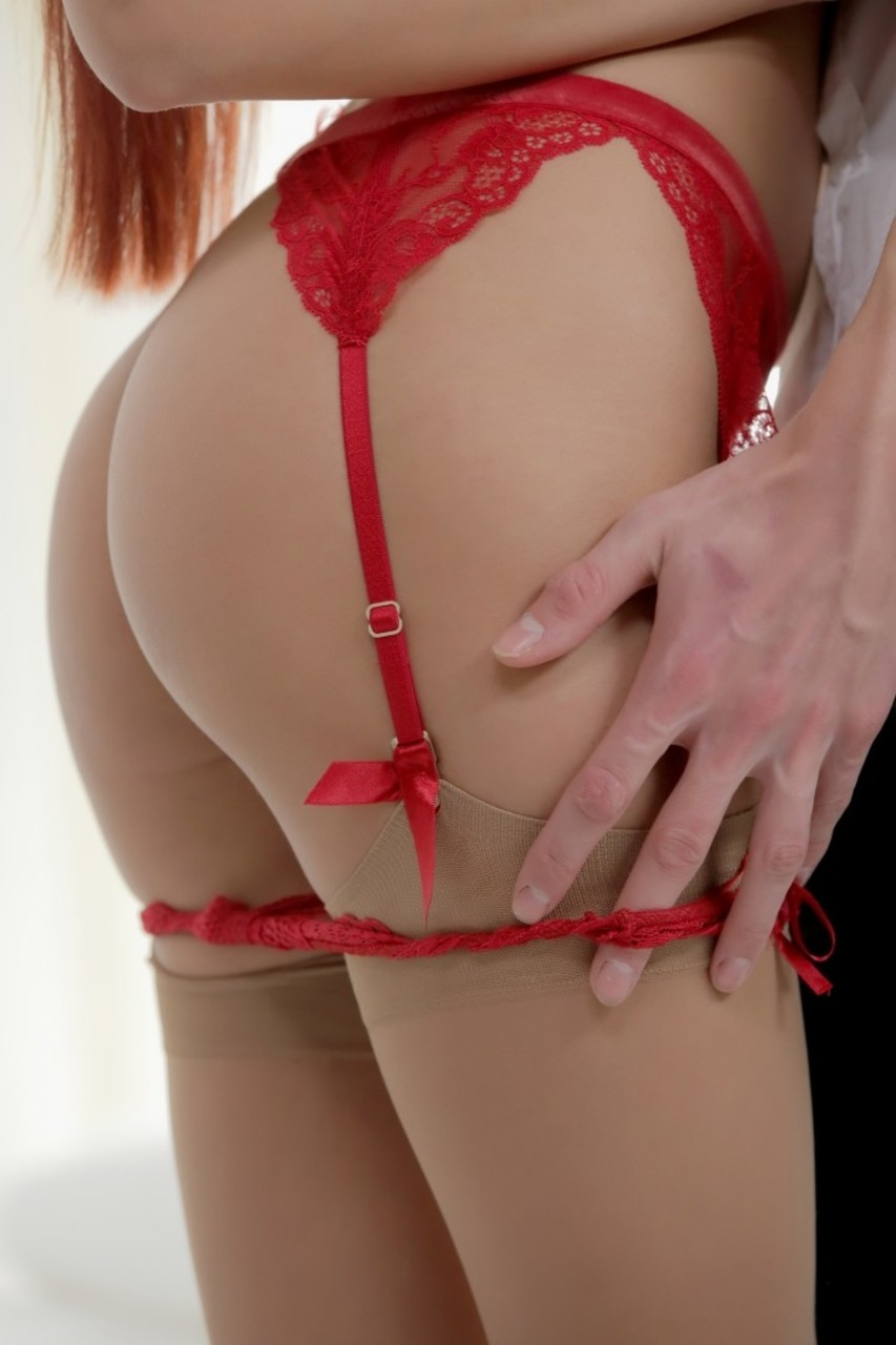 Erotic redhead with natural big tits makes passionate love in red lace garter