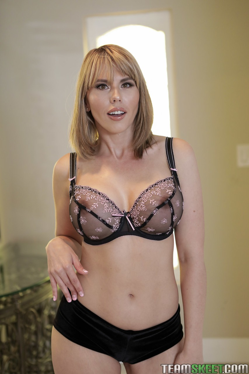 Seductive blonde milf Amber Chase strips and flaunts her big divine tits