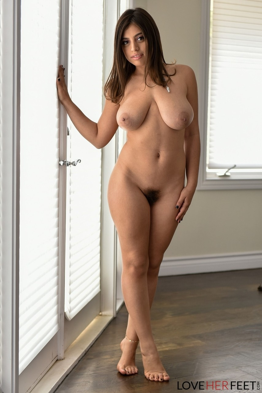 Chubby busty Ella Knox frees her huge natural tits to pose naked on the floor