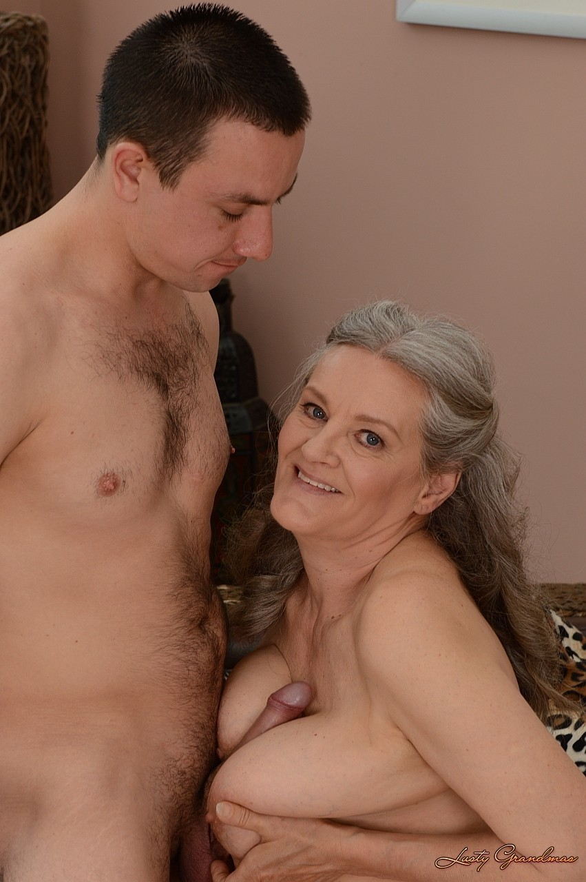 Big boobed granny Aliz gives a rimjob and cock riding to a young guy