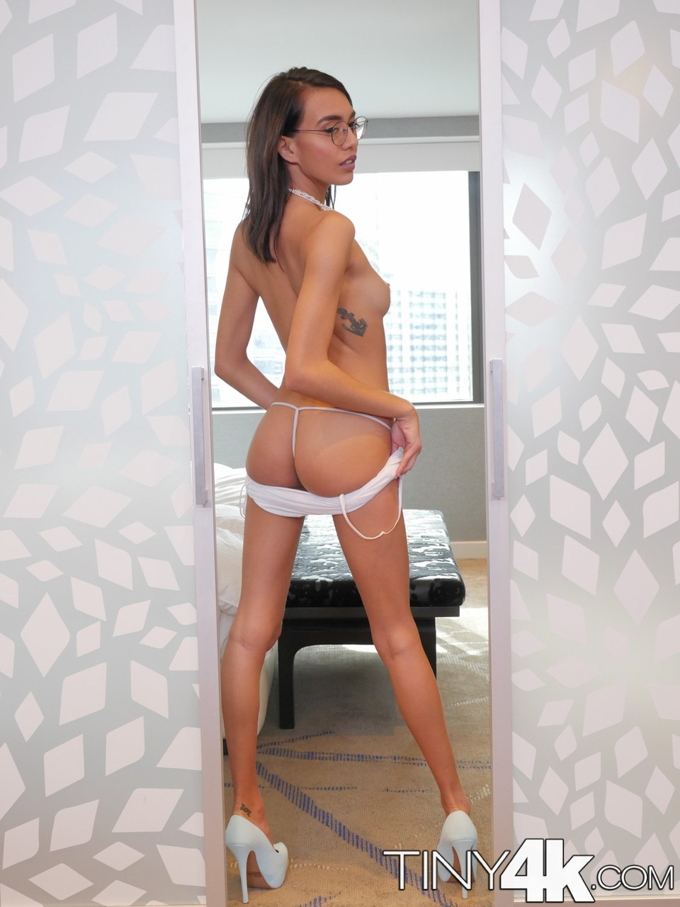 Skinny brunette Janice Griffith take off clothes and flaunting her pussy