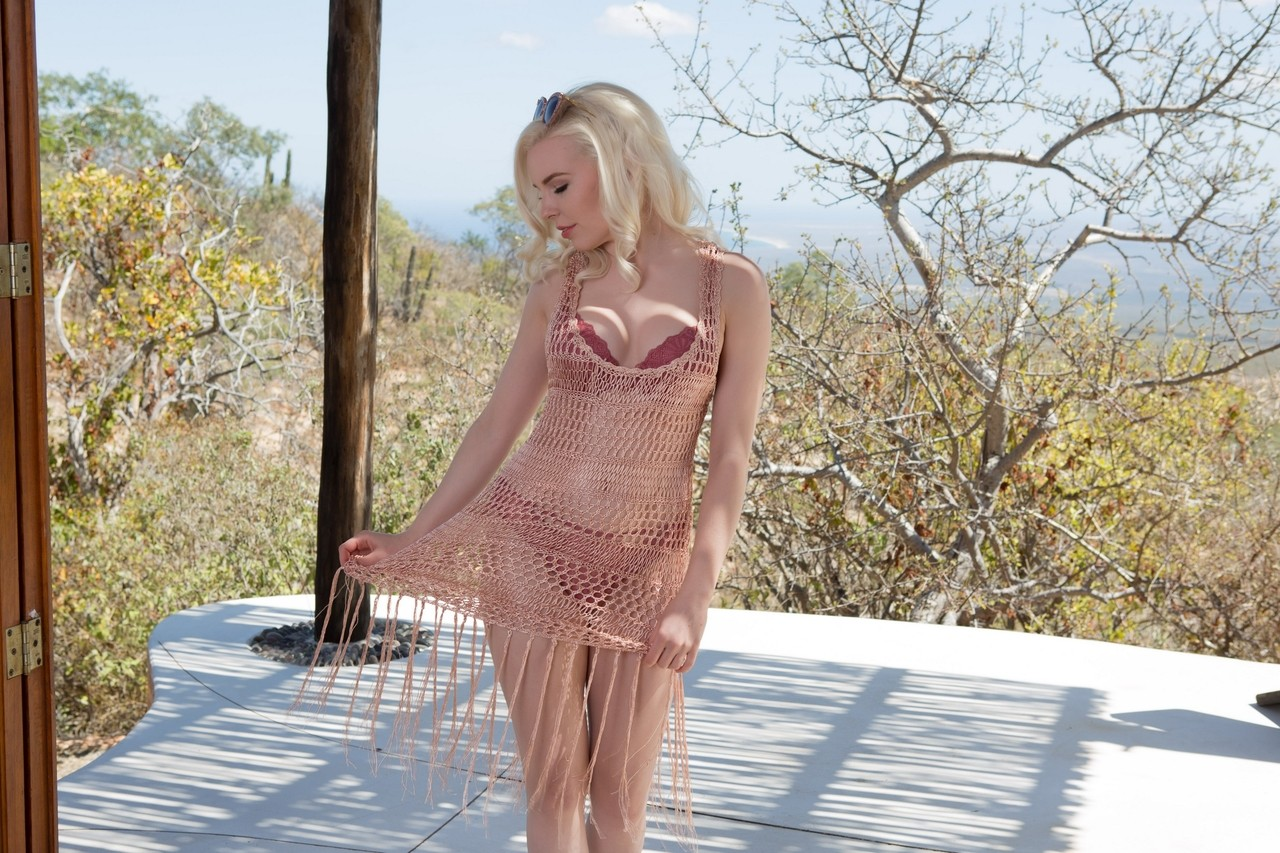 Canadian blonde babe Ali Claire loses her bra outdoors and poses in panties