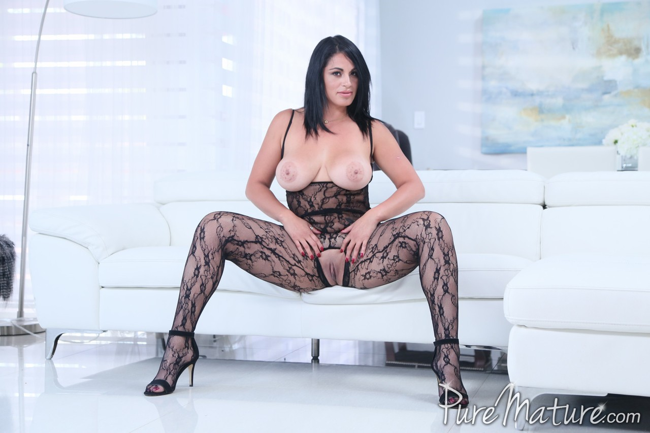 Curvy Cristal Caraballo showing her fake tits and pussy through lace lingerie