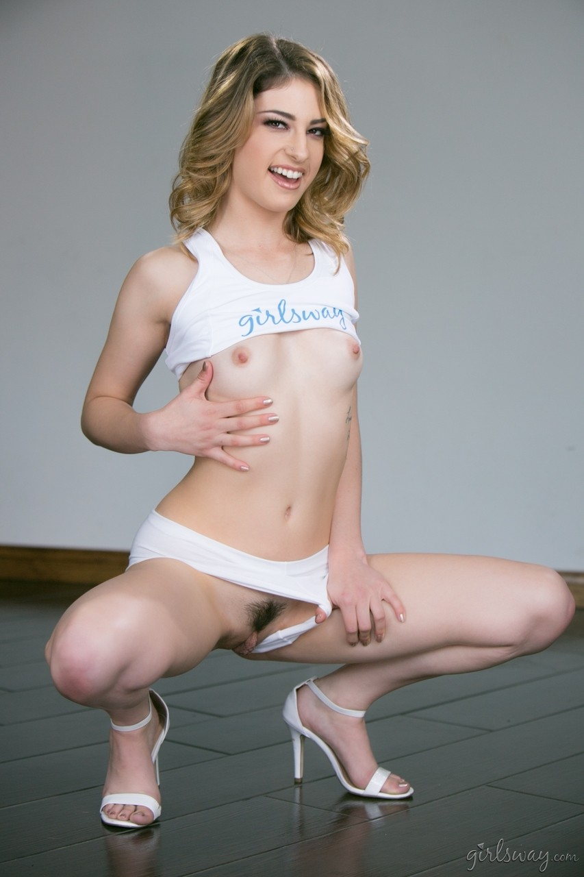 Adorable model Kristen Scott teasing with her skinny body and strips clothes
