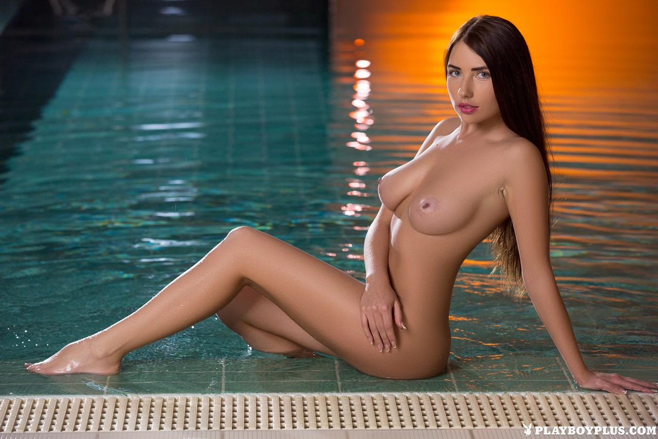 Lovely brunette Niemira looses her white swimsuit & poses naked at the pool