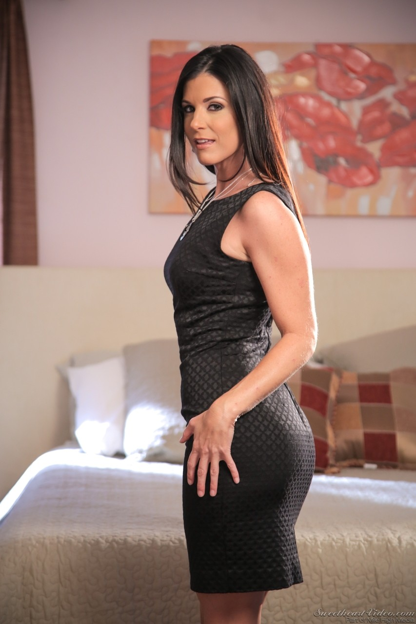 Sultry MILF India Summer removes black dress  poses naked in heels on the bed