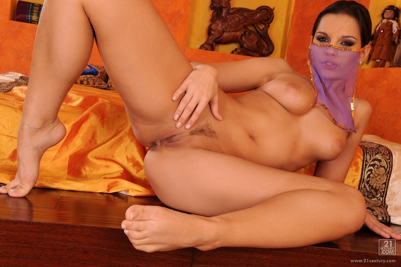 Hungarian brunette milf Eve Angel plays around in a belly dancer costume