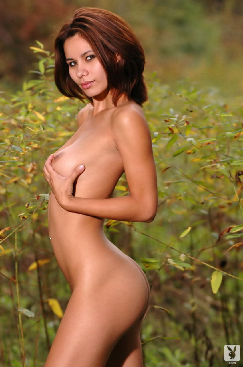 Petite brunette with nice tits Denyse Bui poses nude in various environments