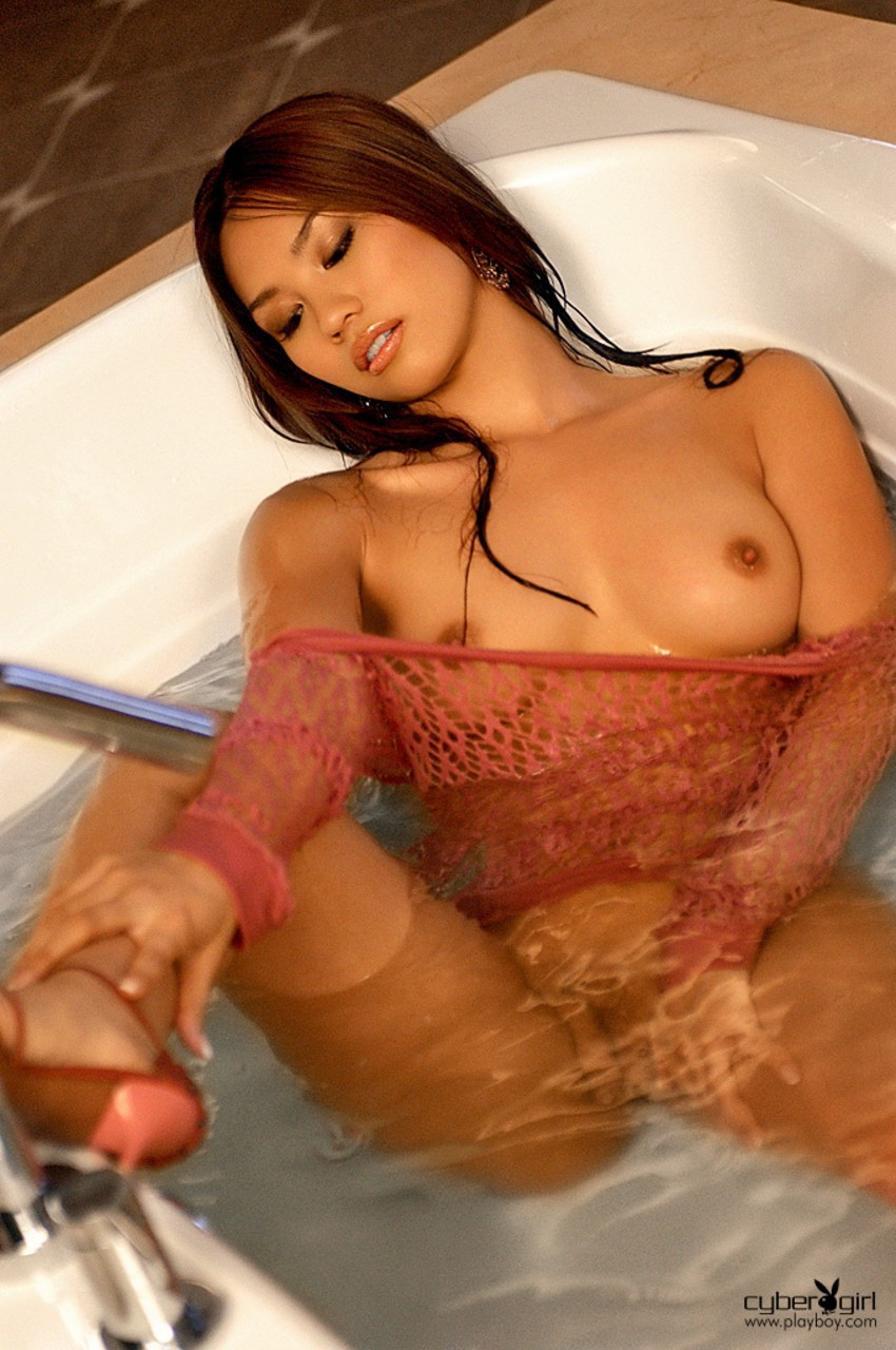 Arousingly beautiful Asian Yen Hoang wets natural tits in the tub in lingerie