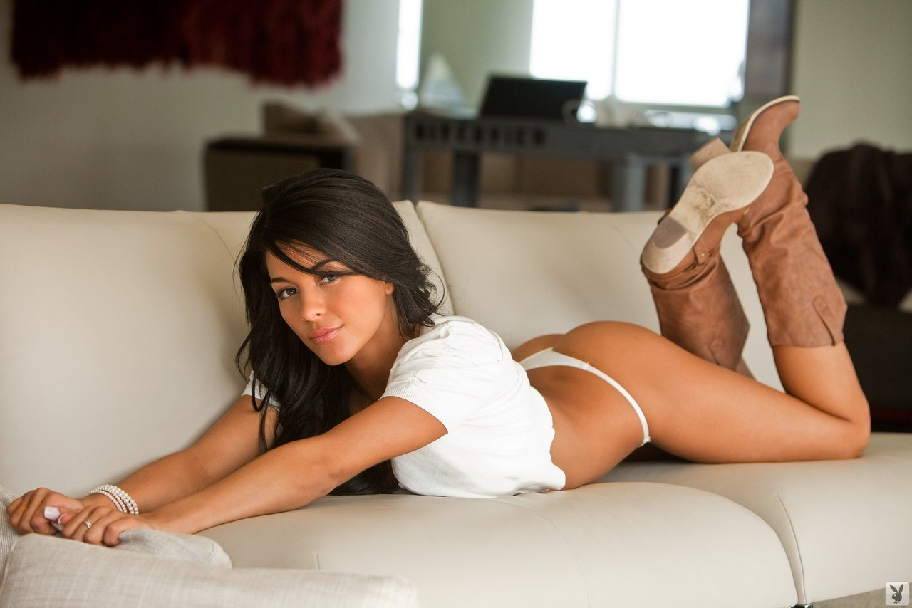 Brunette American model Angie Marie exposes her medium tits and smiles for cam