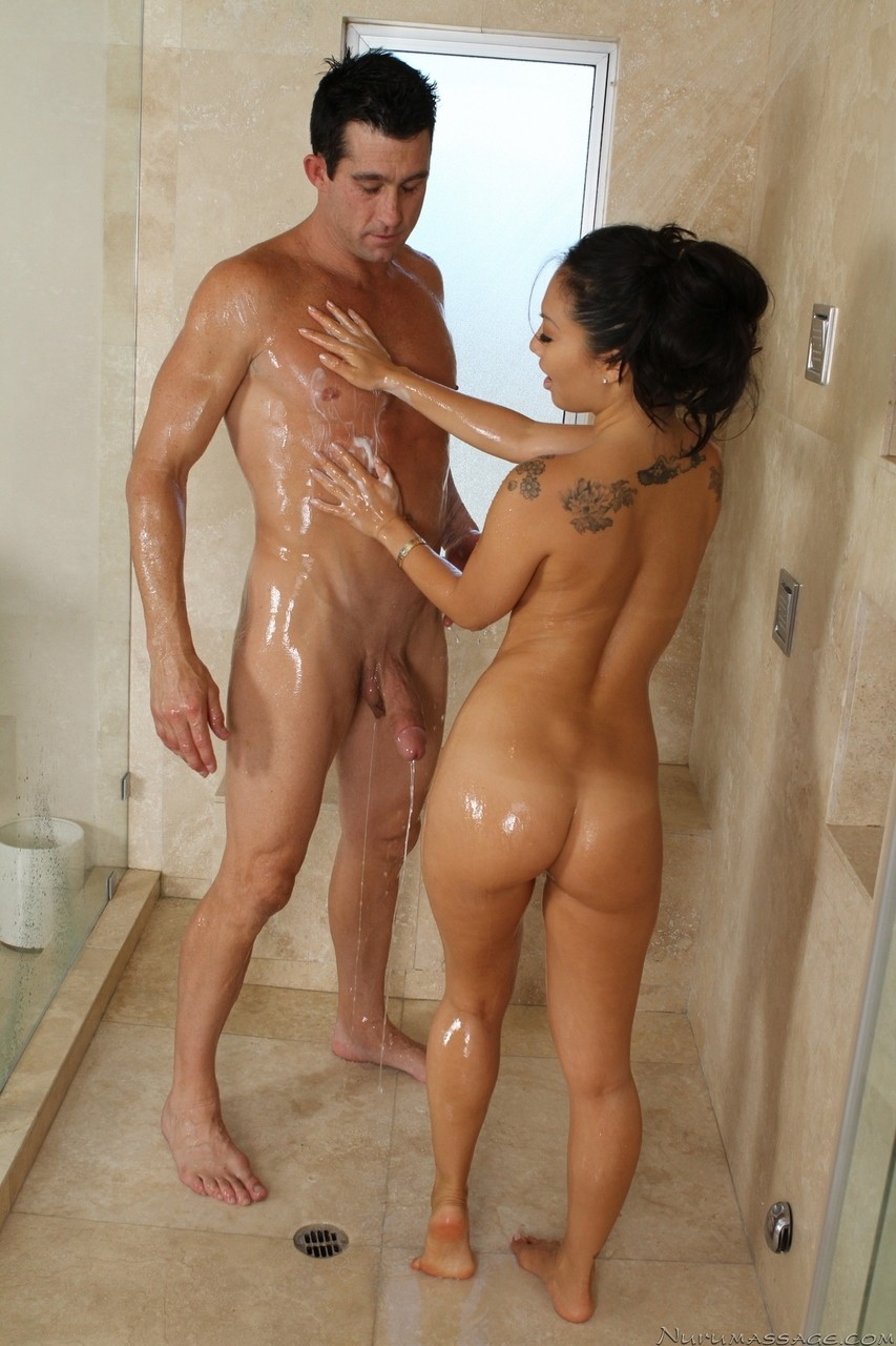 Brunette Asa Akira massaging a guy and his cock and giving him oral