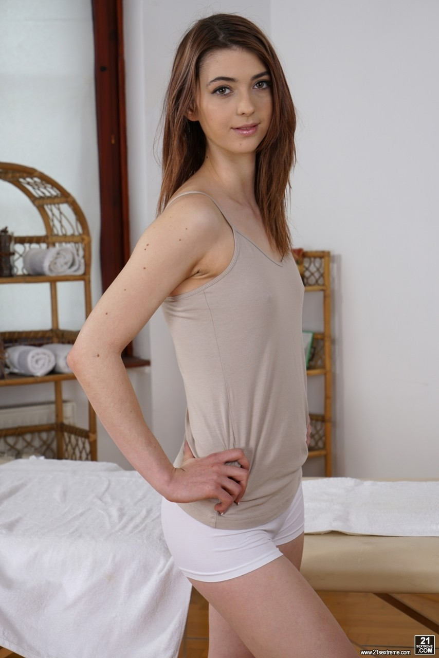 Sinful teen Tera Link undresses and poses nude on massage table