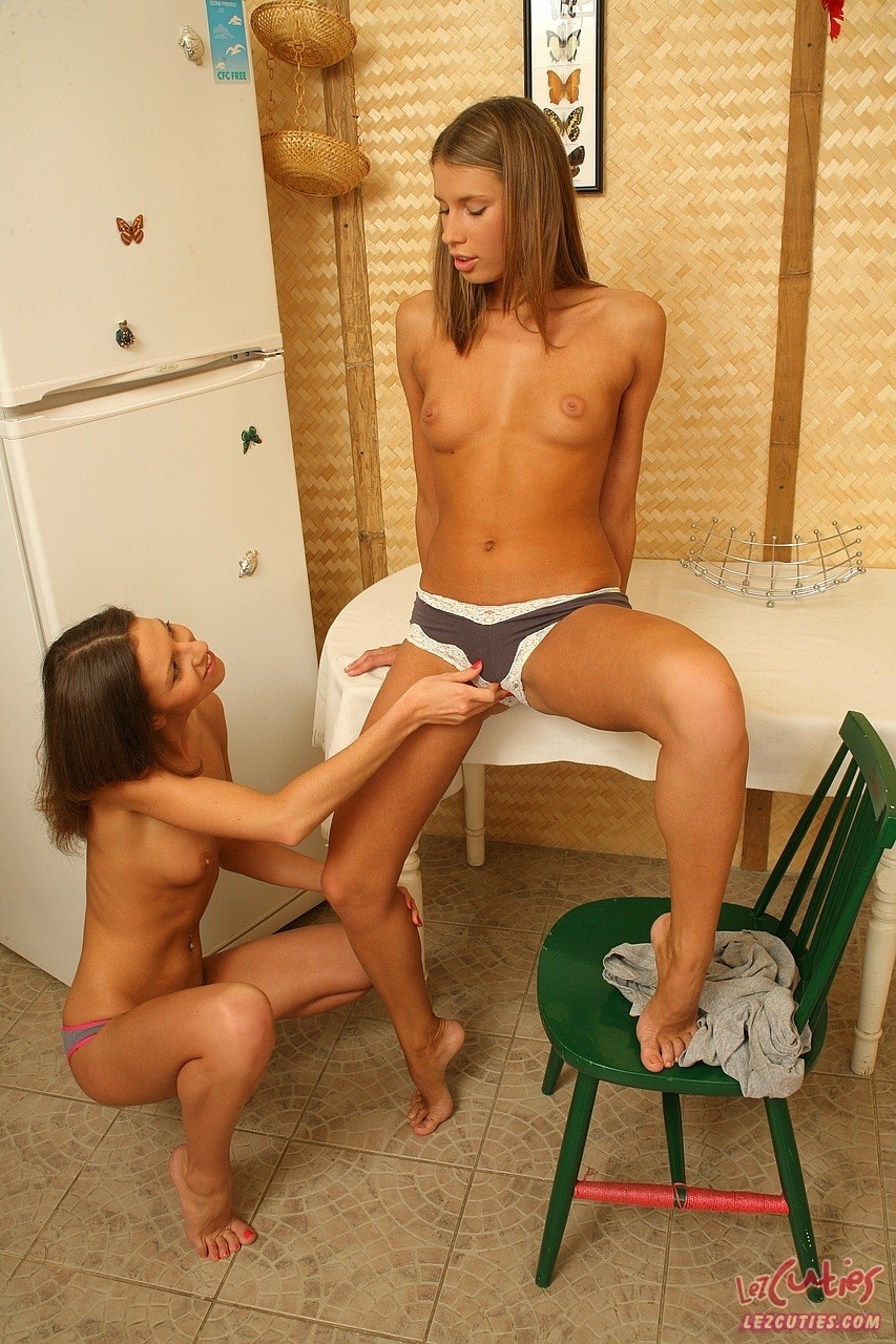 Lesbian teens Natalia and Ally N spread those assholes with their fingers