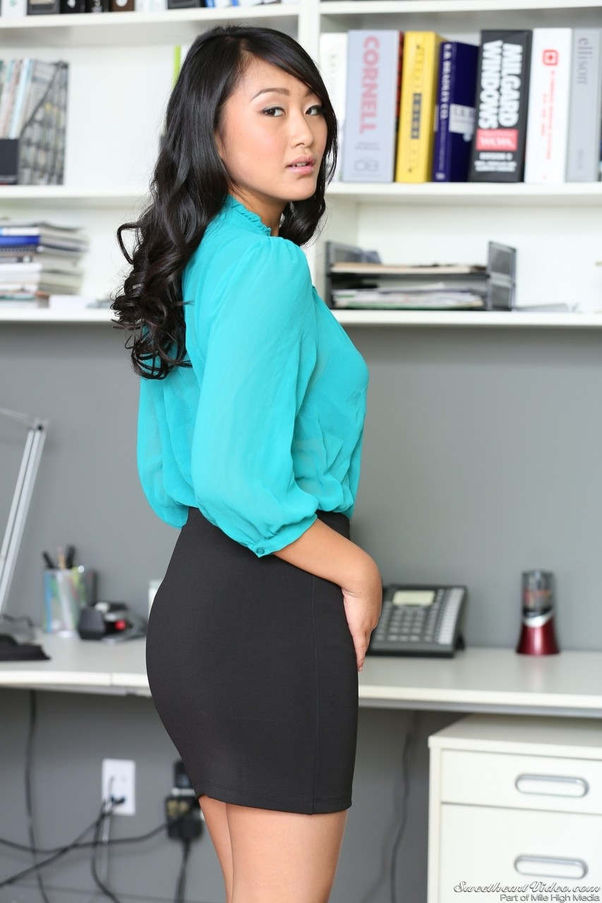 Asian brunette Evelyn Lynn shows her tits and tight pussy in the office