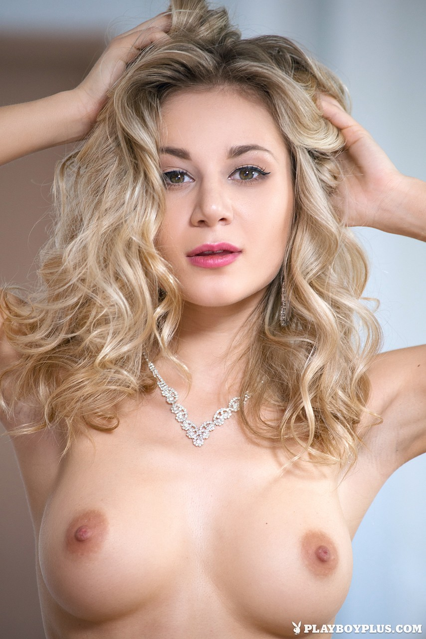Long legged blonde Alice strips her pink dress and displays her natural tits